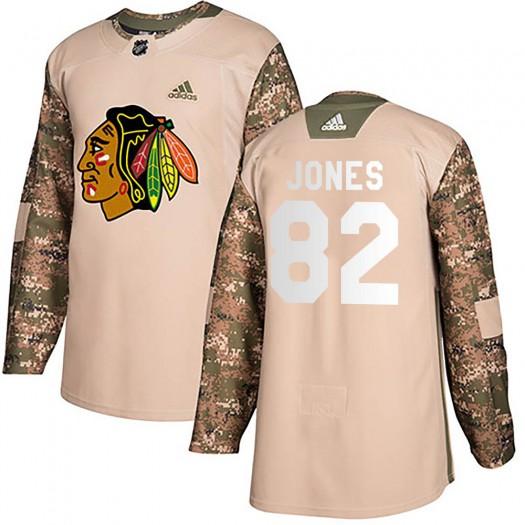 Caleb Jones Chicago Blackhawks Men's Adidas Authentic Camo Veterans Day Practice Jersey