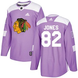Caleb Jones Chicago Blackhawks Men's Adidas Authentic Purple Fights Cancer Practice Jersey