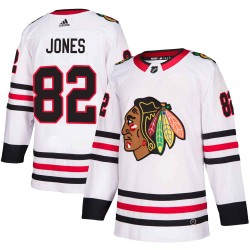 Caleb Jones Chicago Blackhawks Men's Adidas Authentic White Away Jersey