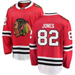 Caleb Jones Chicago Blackhawks Men's Fanatics Branded Red Breakaway Home Jersey