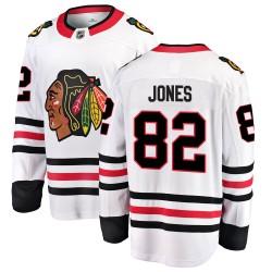 Caleb Jones Chicago Blackhawks Youth Fanatics Branded White Breakaway Away Jersey